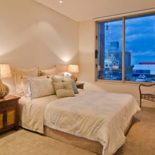 Master Bed Seaside Apartment - Staging